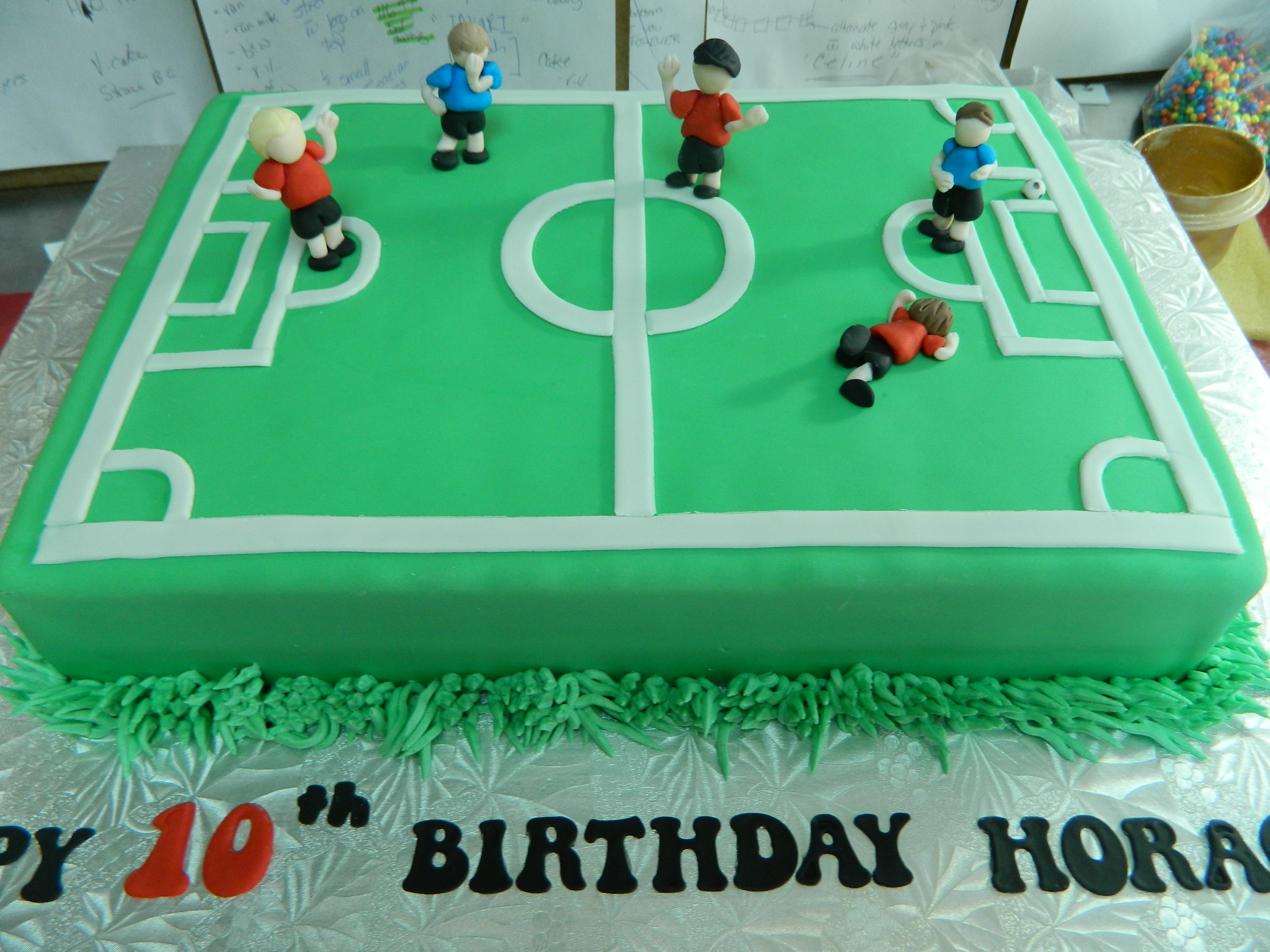 Soccer field themed custom cake