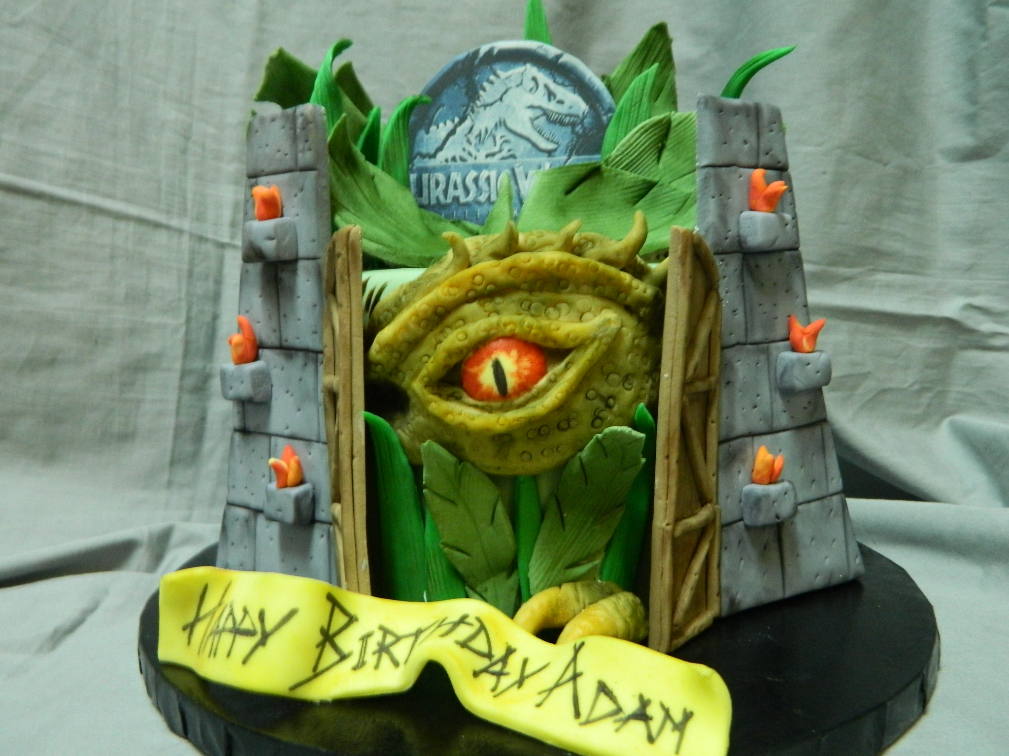 Jurrasic World themed custom birthday cake