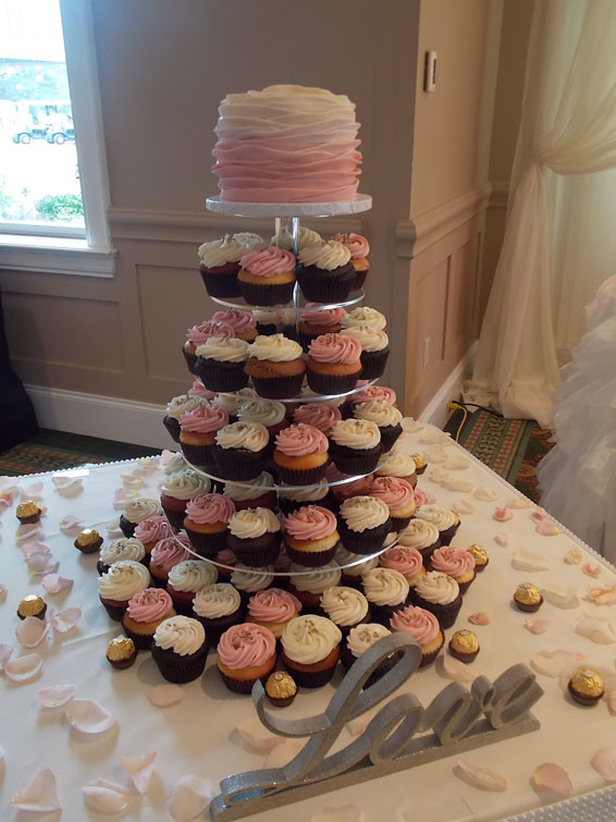 Pink Ombre topper wedding cake (with wedding display cupcakes)