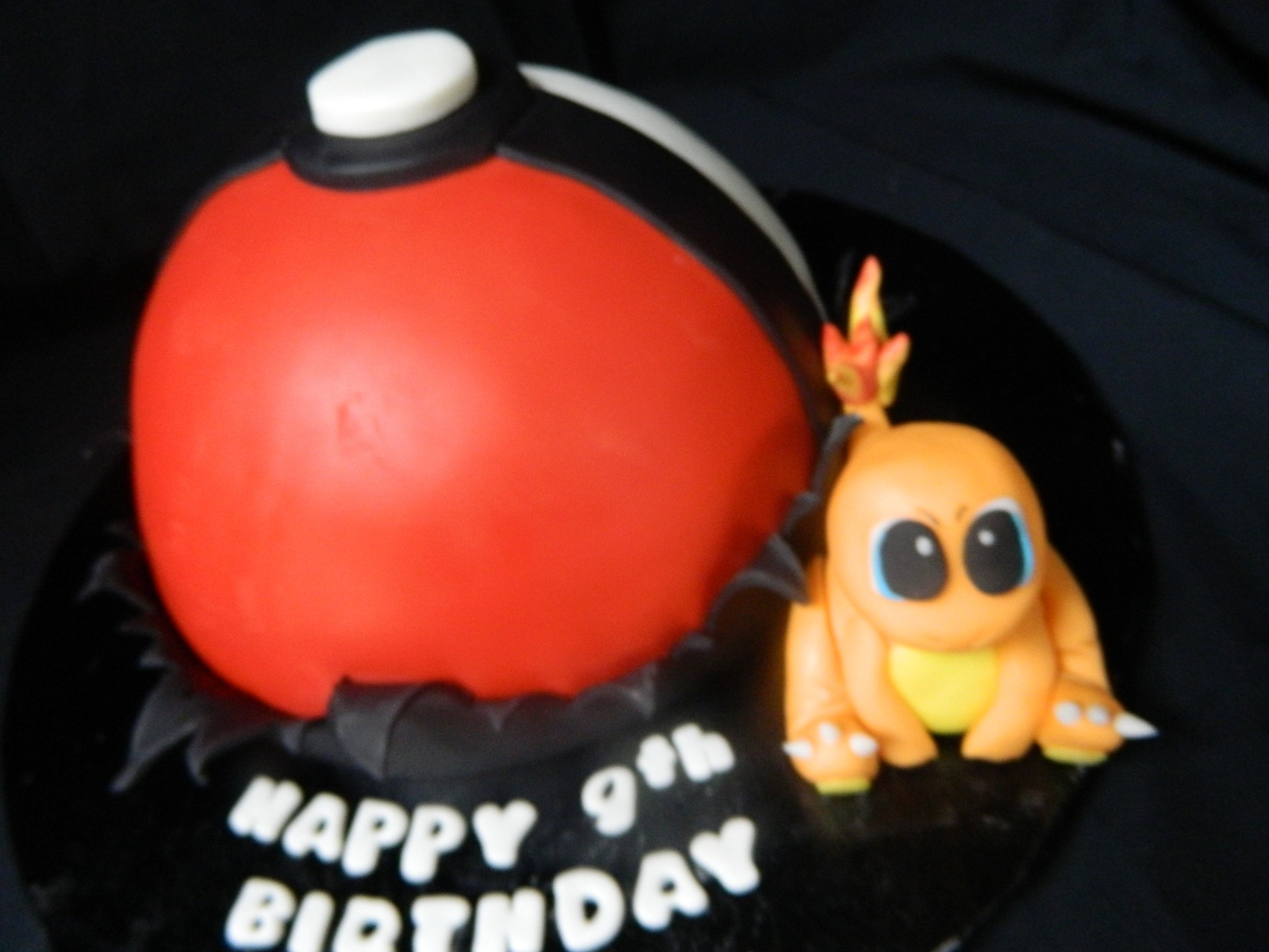 Pokeball with Charmander custom cake