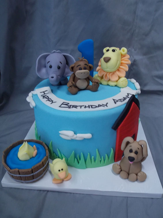 First birthday custom cake with jungle animals (and a puppy and ducks)