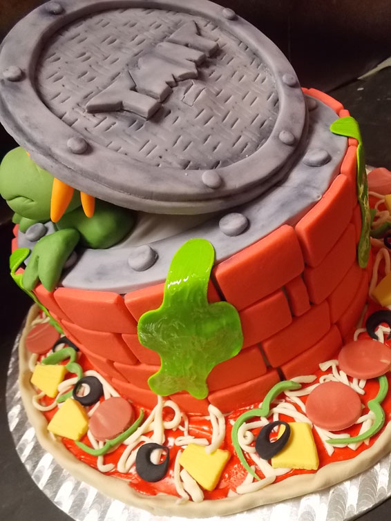 back of Teenage Mutant Ninja Turtles custom cake