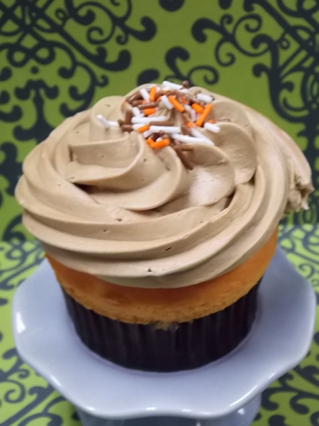 Tangerine cupcake topped with Root Beer buttercream