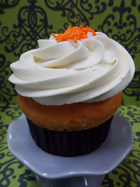Creamsicle-Tangerine cupcake topped with Madagascar vanilla buttercream and orange sprinkles