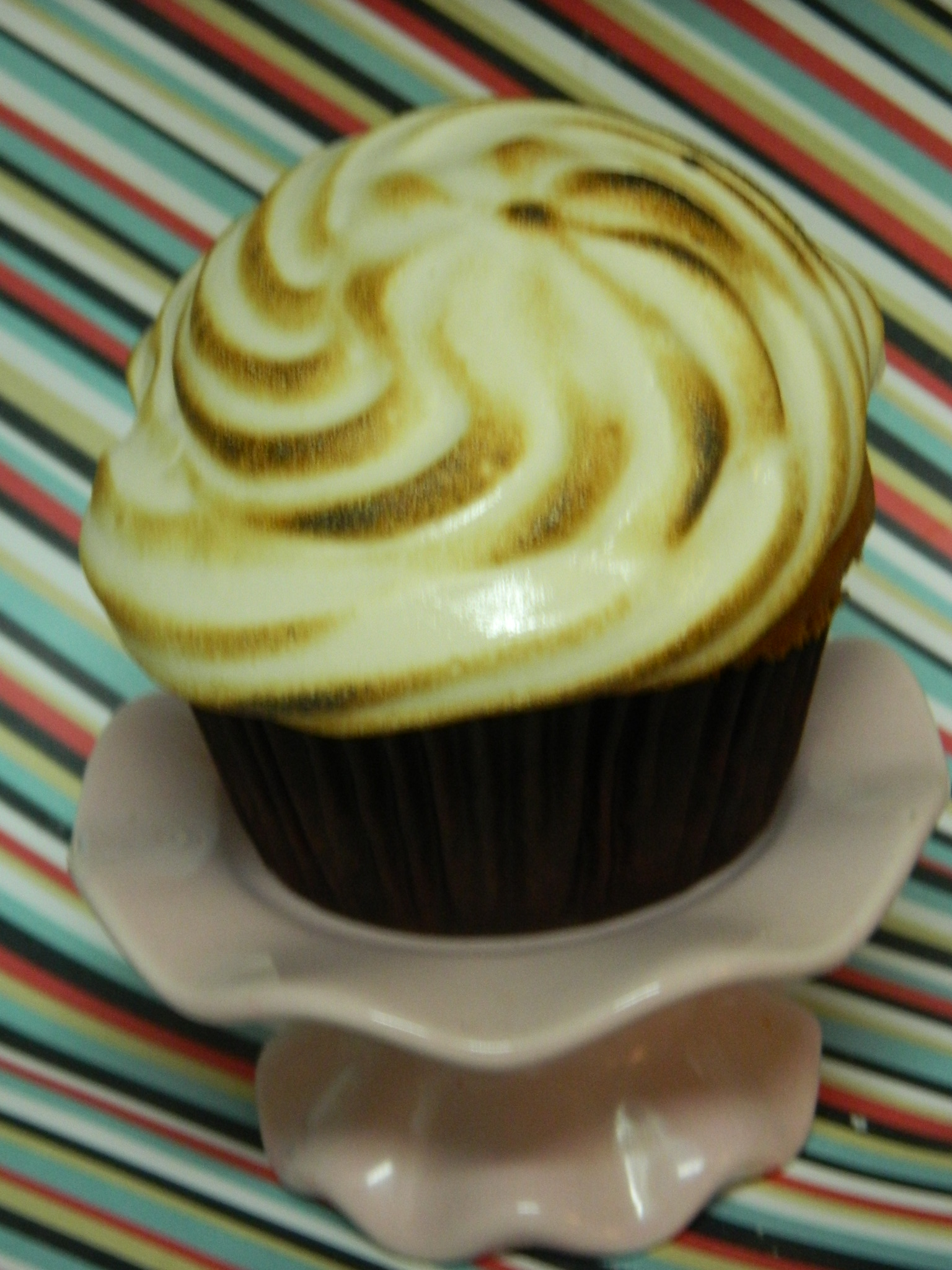Fluffernutter-Banana cupcake with peanut butter cream filling and marshmallow cream topping