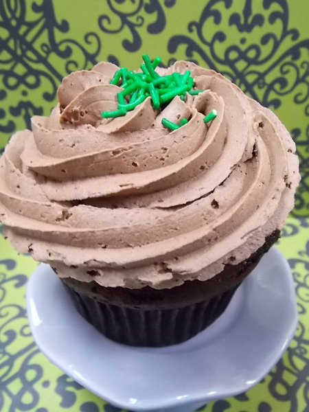Chocolate cupcake with a peppermint patty centre and topped with milk chocolate buttercream & sprinkles of mint