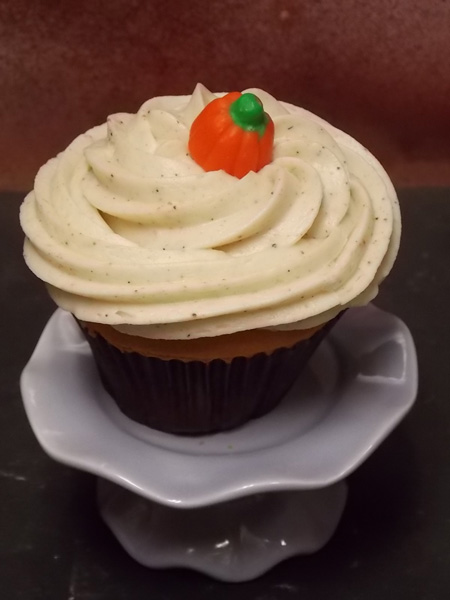 Festive pumpkin cupcake topped with a 'spiced' up cream cheese icing